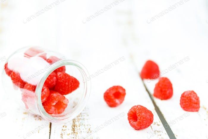 Variety of fresh raspberries on wood.