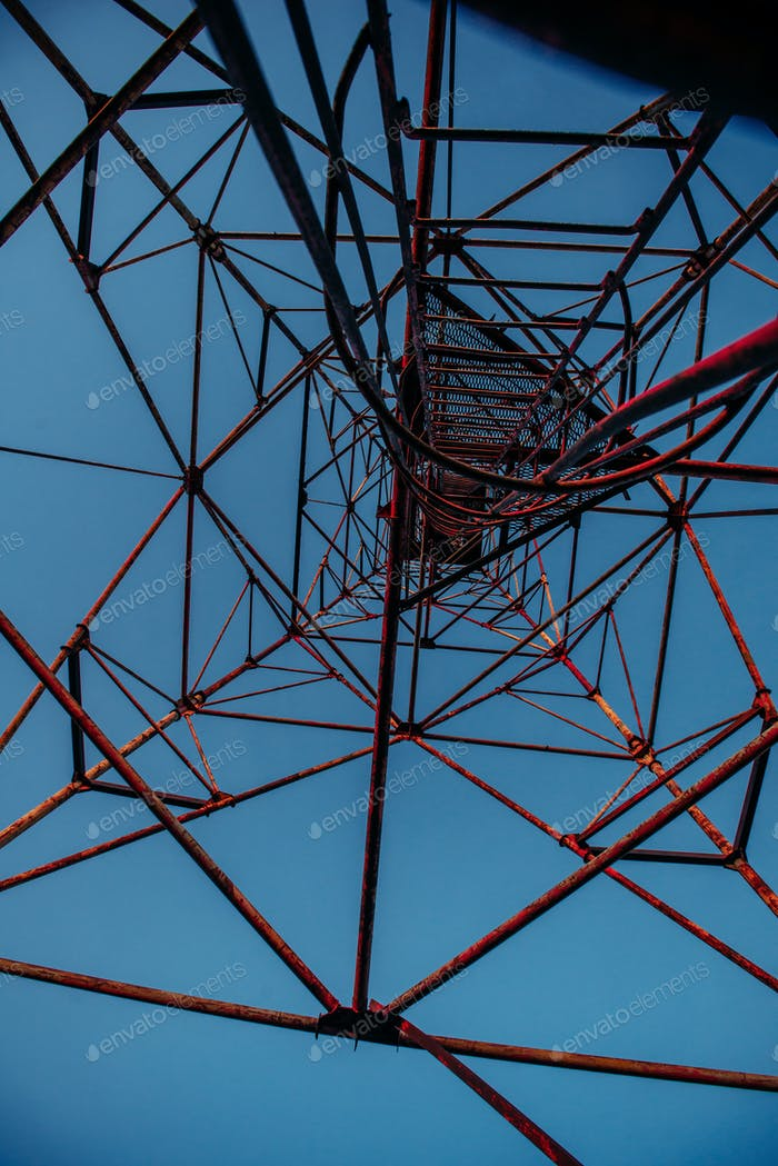 High metal tower on blue sky