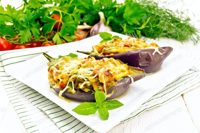 Eggplant stuffed brisket and vegetables in plate on light board
