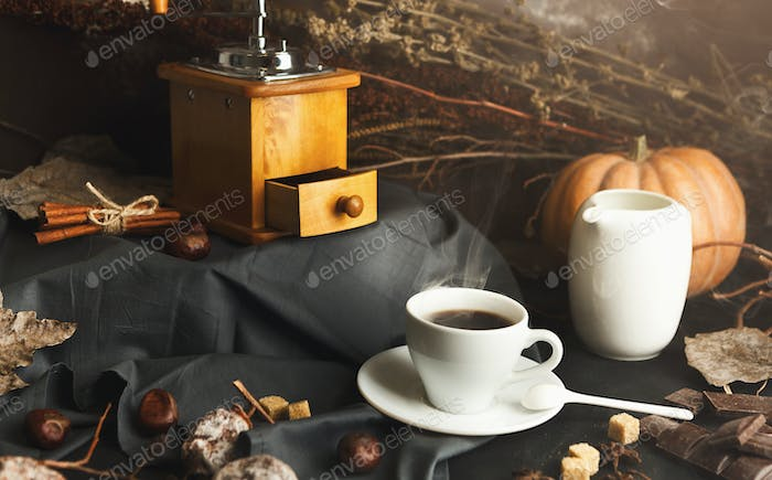 Coffee cup and sweets on vintage wooden table