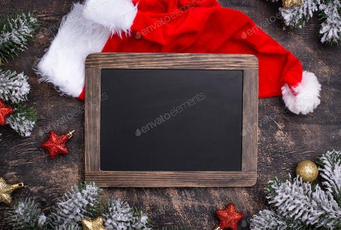 Christmas dark background with Santa hat