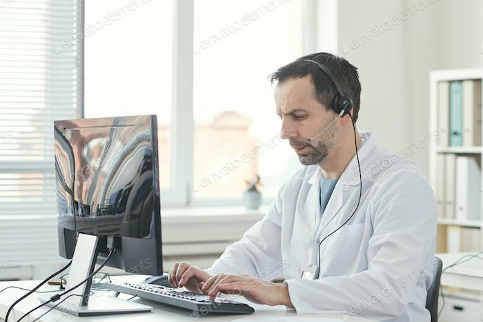 Man working in medical call center