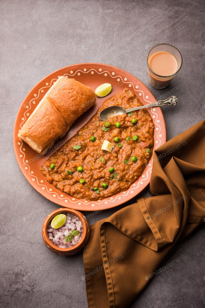Pav bhaji is a popular Indian street food that consists of a spicy mix vegetable mash & soft buns