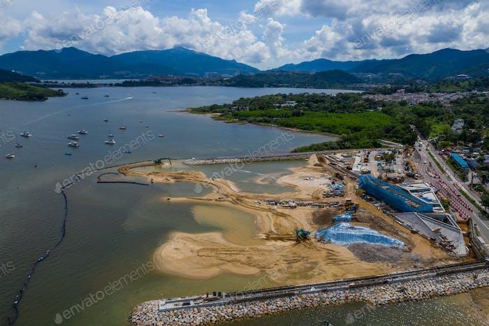 Top view of building a artificial beach