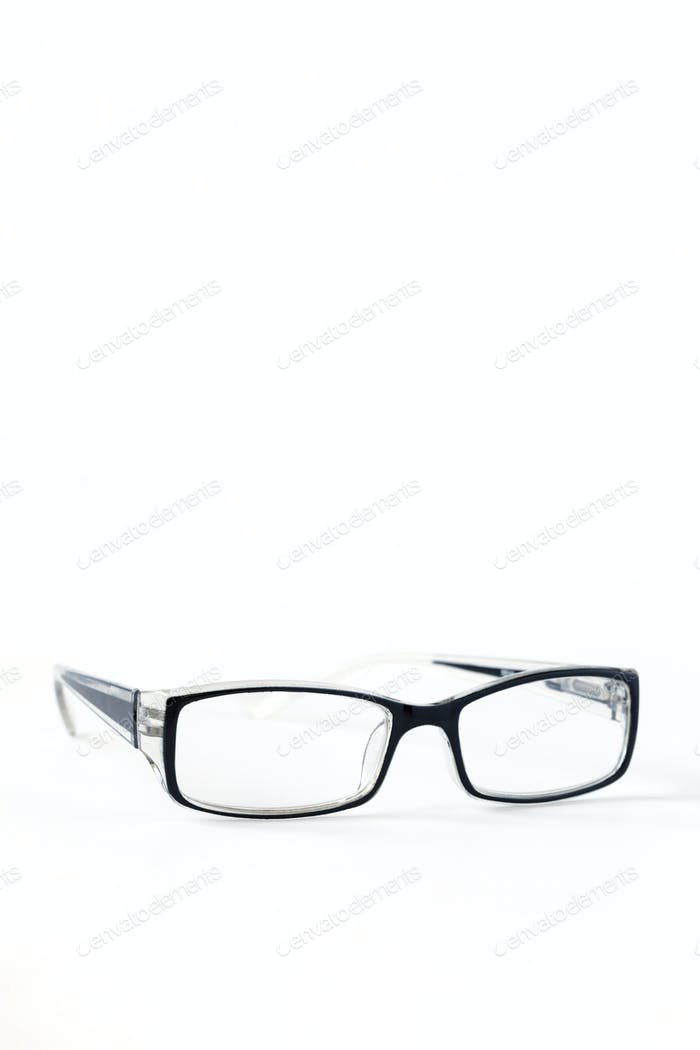 Glasses in a black frame on a white isolated