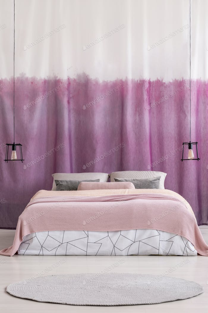 King-size bed with pink blanket