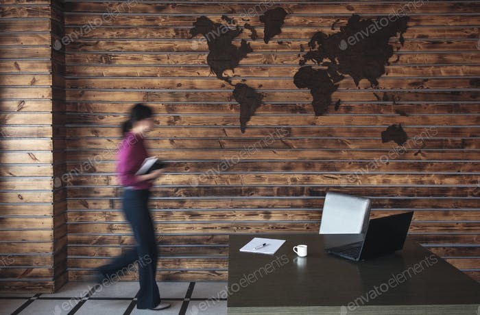 Blurred businesswoman walking to her desk