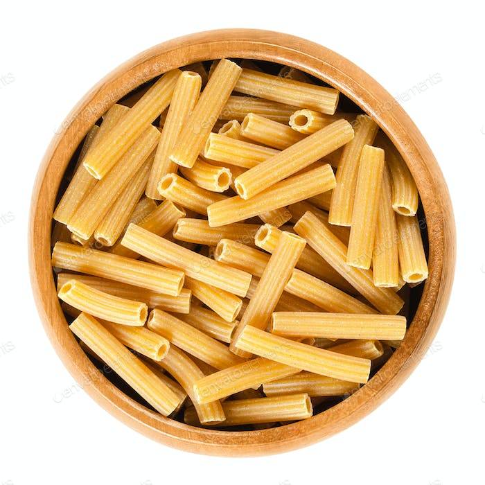 Chickpeas sedanini pasta in wooden bowl over white