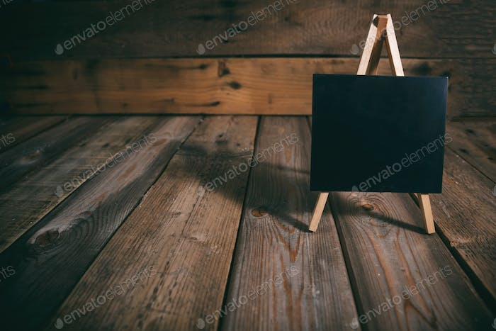 Blackboard on dark wooden background, copy space