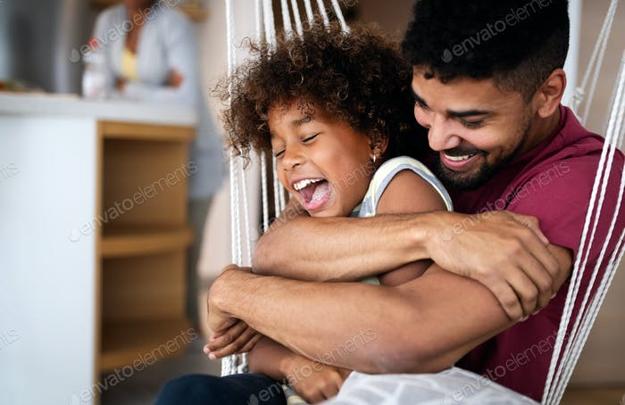 Happy family and father's day. Child daughter kissing and hugging with dad
