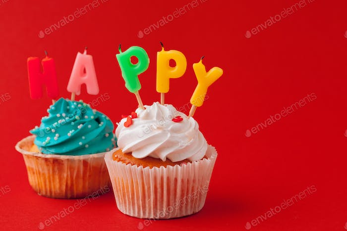 Happy birthday cupcakes on bright colored background