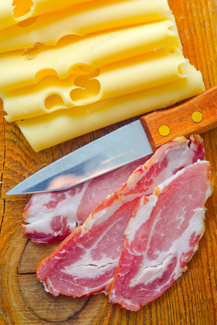 Bacon with cheese on the wooden board