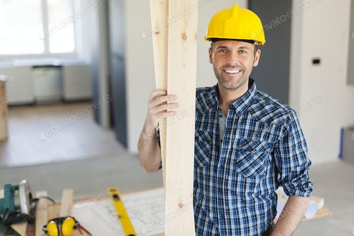 Portrait of happy and handsome carpenter