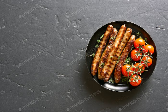 Roasted sausages and cherry tomatoes