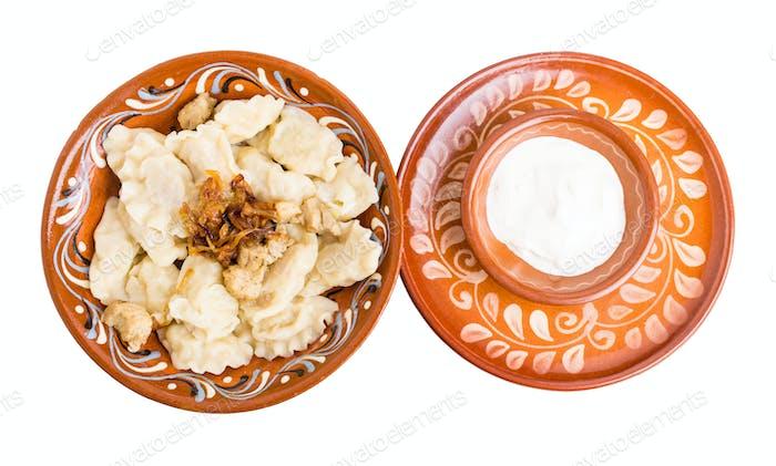 Russian dumplings pelmeni with meat.