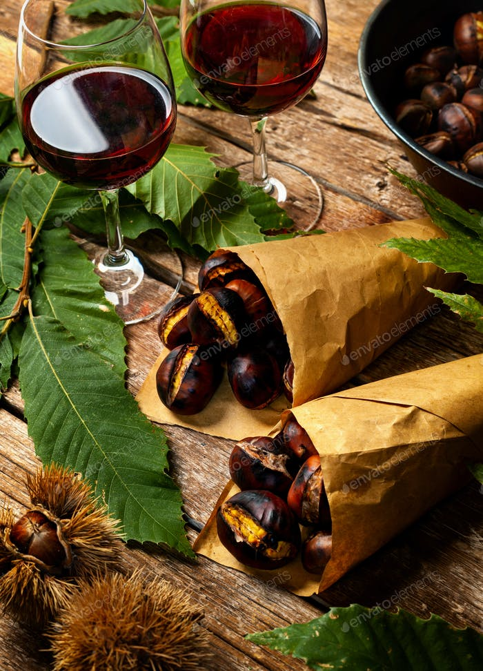 Roasted chestnuts in paper cones.