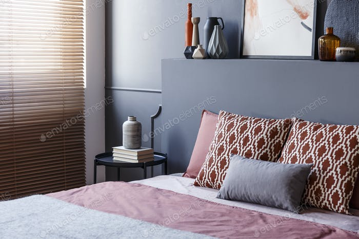 Close-up of patterned pillows lying on a soft bed in bedroom int