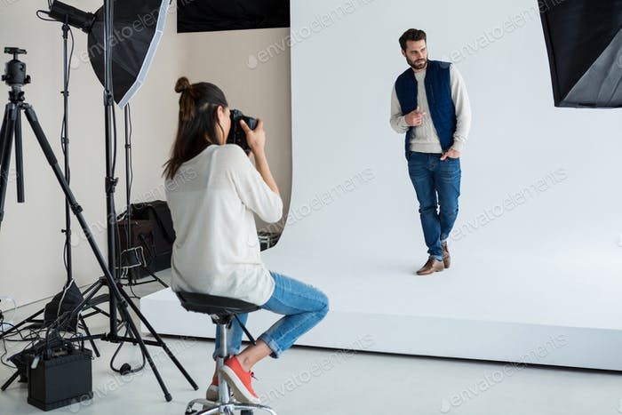 Male model posing for photographer
