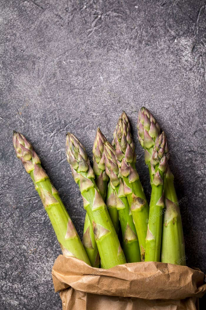 Fresh green asparagus in a paper bag. Healthy eating concept.
