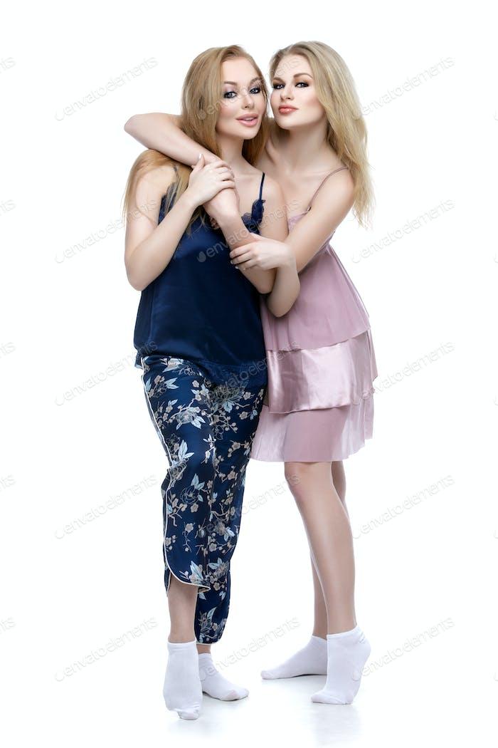 Two beautiful girls in night wear