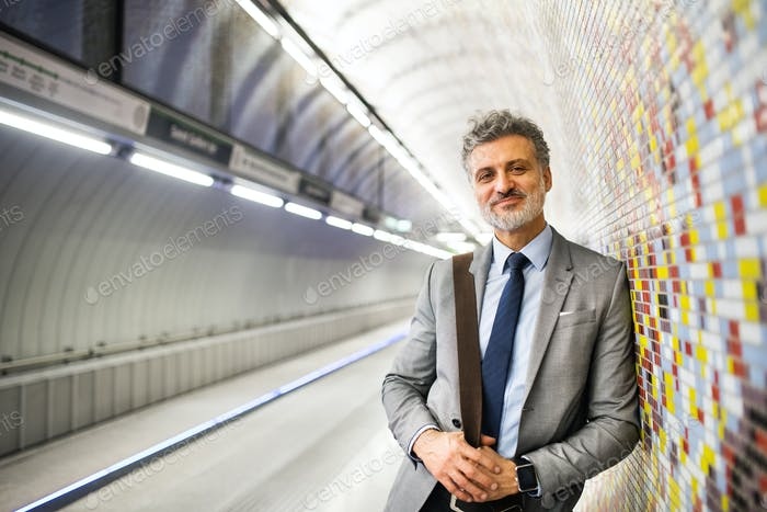 Mature businessman waiting on a metro station.