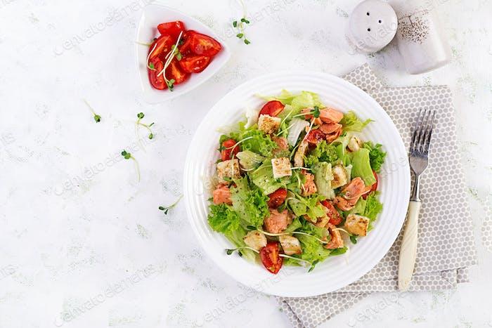 Caesar Salad with Salmon. Fish menu. Seafood - salmon. Top view, overhead, copy space