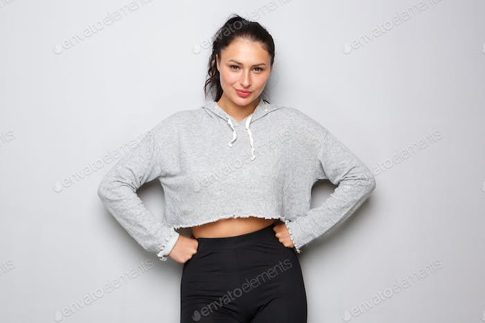 athletic woman standing with determined expression