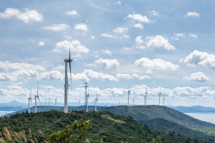 wind farm against a sunny sky