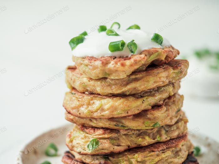 Traditional zucchini fritters, served sour cream
