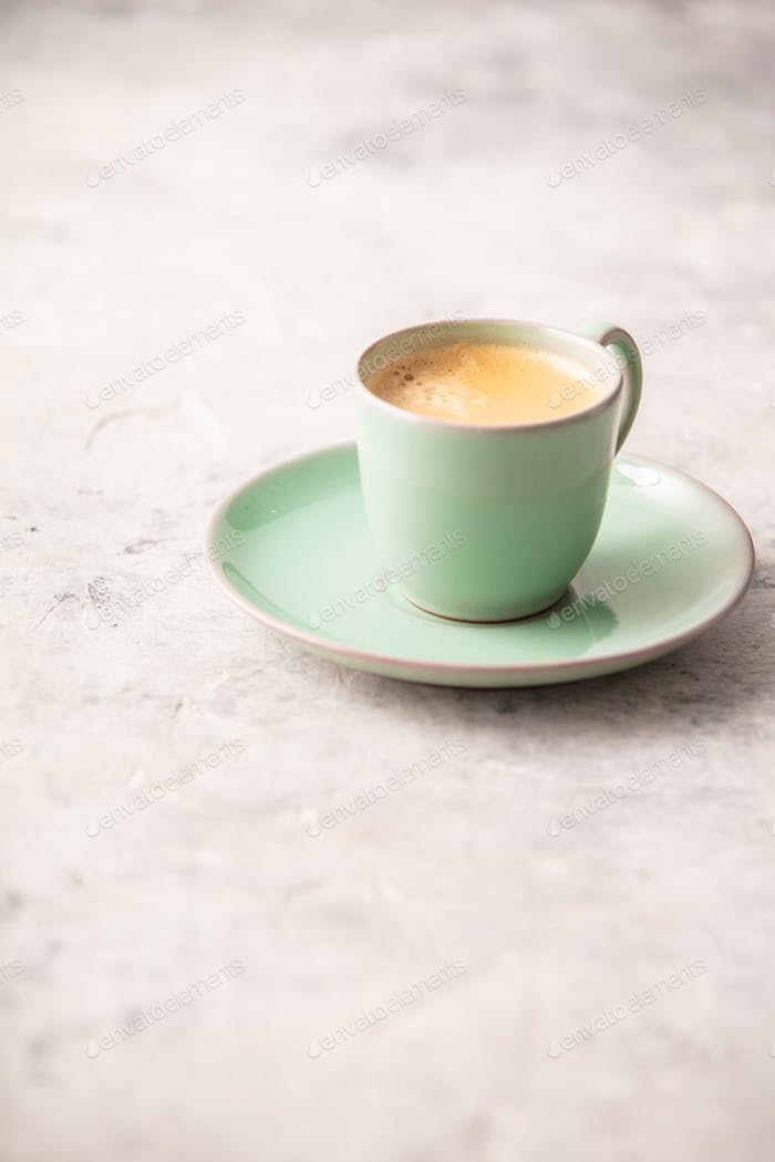 A cup of coffee on light grey background
