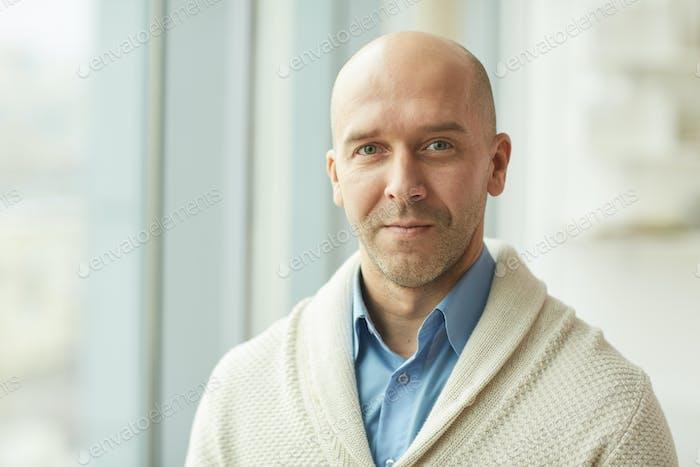 Balding Mature Man in Office