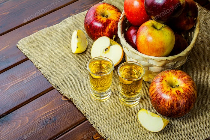 Apple brandy shots and red apples