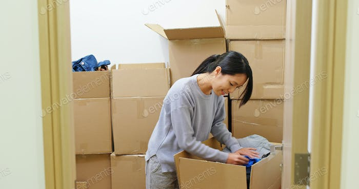 Woman find something inside the box