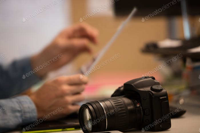 Camera on desk by photographer in creative office