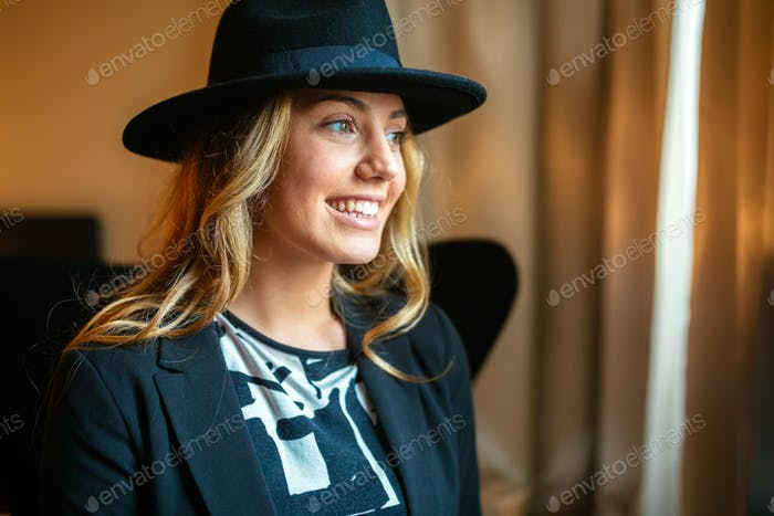 Cheerful woman wearing hat