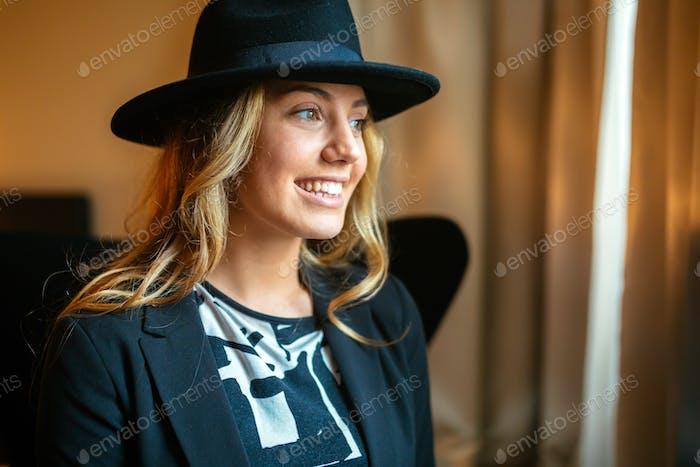 Cheerful woman wearing hat