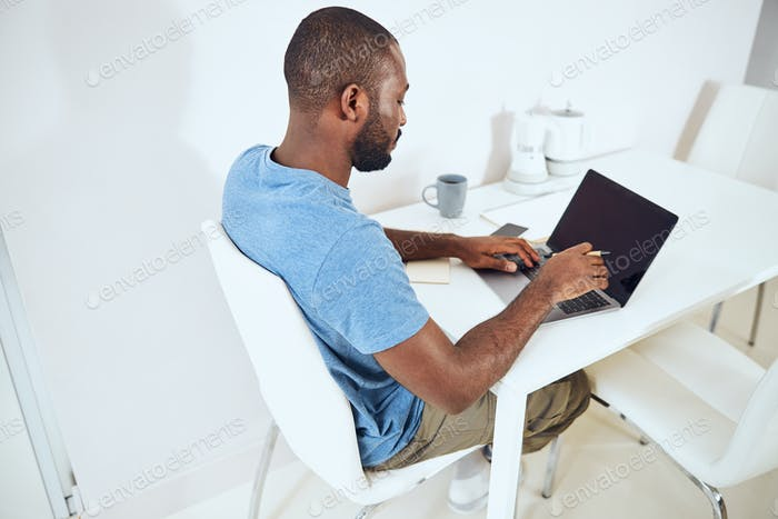 Hard-working man is typing on a keyboard