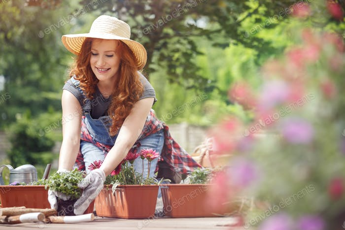 Girl relaxing during gardening work