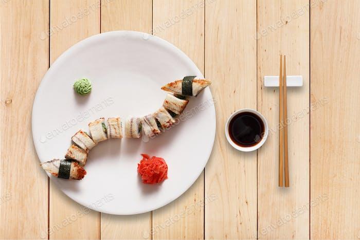 Set of sushi unagi rolls at wood.