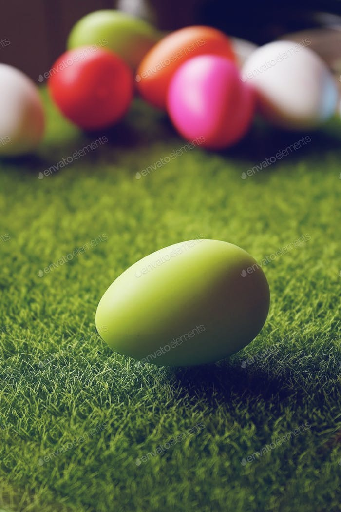 A beautiful and colorful close-up of green easter egg over green