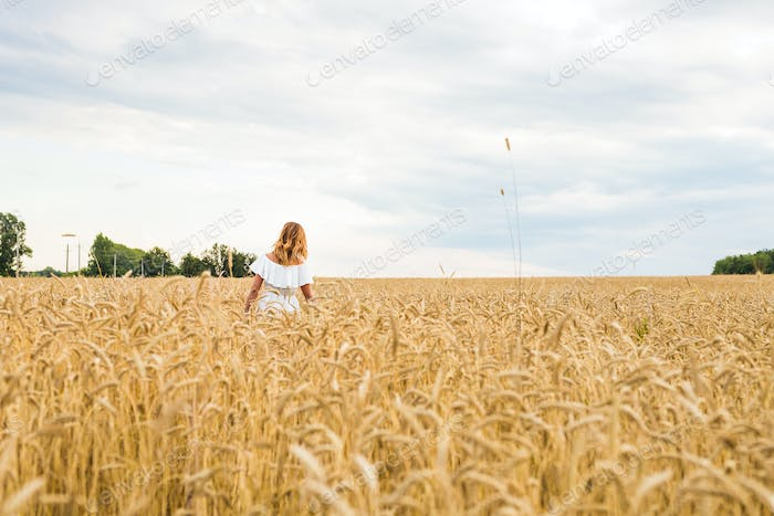 Autumn Girl enjoying nature on the field. Free Happy Woman