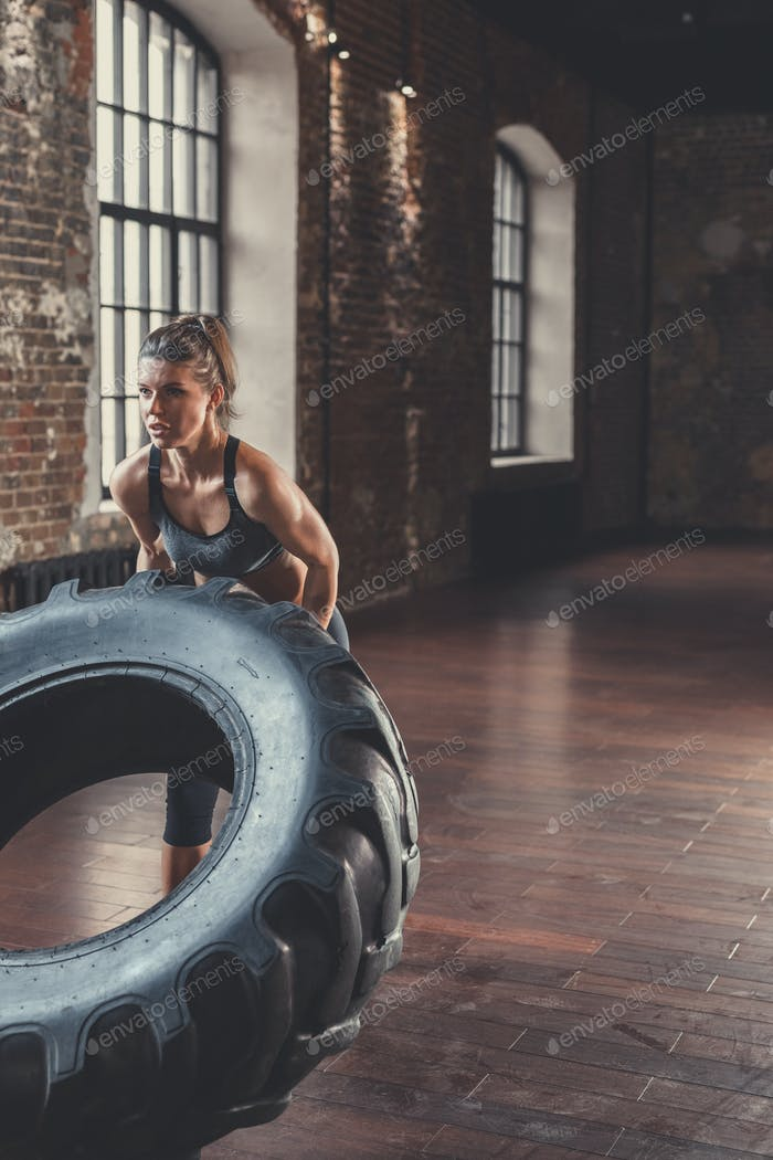 Athletic young woman with a wheel