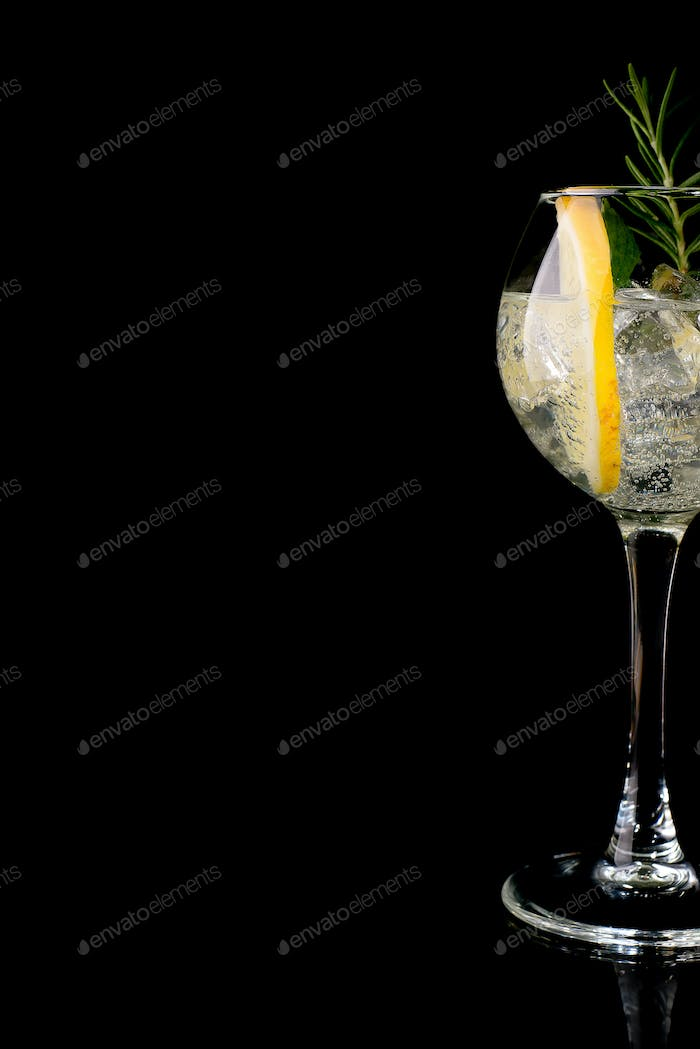 Glass of a cold cocktail drink with white wine