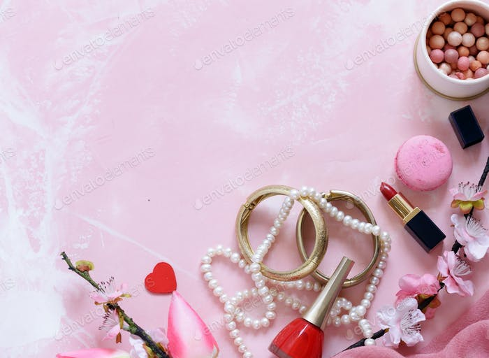 Pink Background with Cosmetics and Jewelry