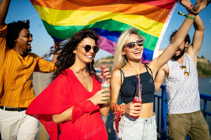 Group of friends, people attend a gay pride event