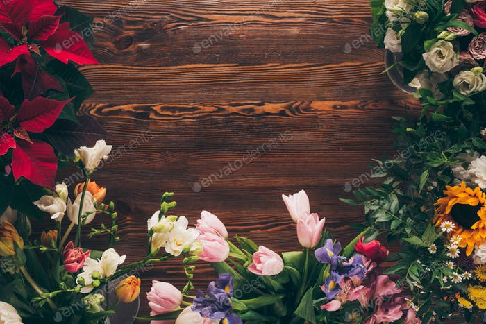 top view of colored flowers on table in flower shop