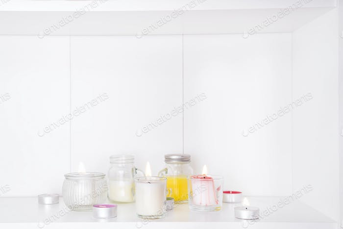 Set of various candles isolated on white
