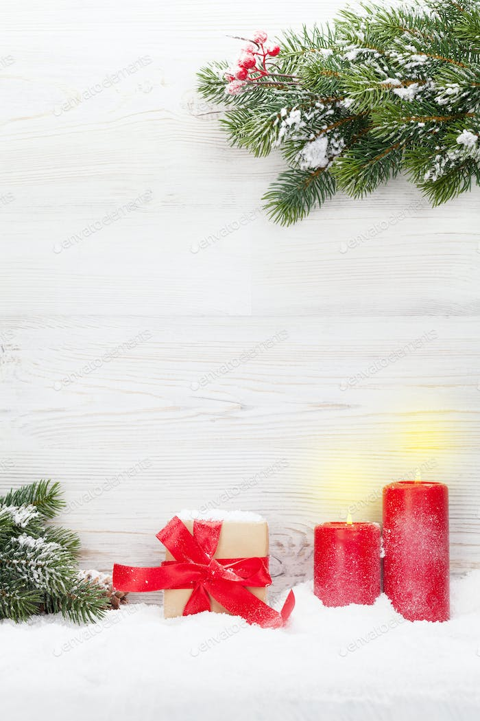 Christmas gift box, candles and fir tree