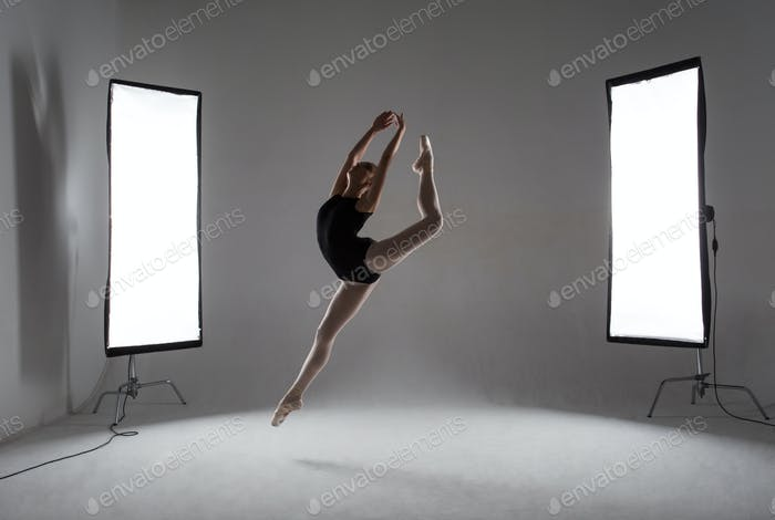 Backstage shooting a graceful ballerina in the studio