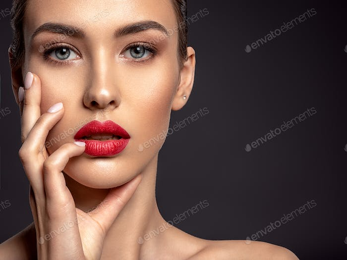 Beautiful woman with bright make-up and red lips.